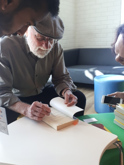 Helping Don sign the books